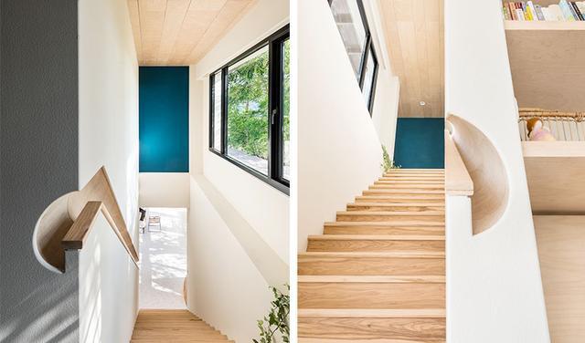 位于书墙一侧的楼梯通往卧室,扶手结合内推方式设计暗扶手,避免日常磕碰。沿着木质踏板通往二楼,尽头一抹深色点缀,更显空间层次。